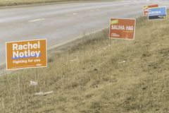 April 7 2019 - Calgary., Alberta , Canada - Candidate campaign signs on road for provincial elections stock photography