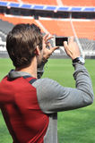 Dario pictures of the stadium on your phone Royalty Free Stock Photo