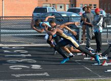 High School track meet, Start the 100 meter dash royalty free stock images