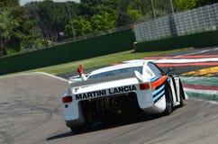 21 April 2018: Emanuele Pirro drive Lancia Martini Beta Montecarlo during Motor Legend Festival 2018. At Imola Circuit in Italy royalty free stock image