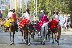 April Fair in Seville. Seville, Spain, 8 may, 2014: People mounted on horse on fair of Seville stock images