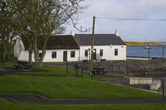 17 April 2018 The famous Irish cottages at Cockle Row in Groomsport Harbour in County Down Northern Ireland. A popular destination Stock Images