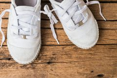 April fool`s day concept. Shoelaces tied together on wooden background royalty free stock image