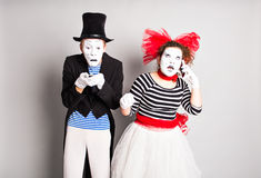 April Fool's Day concept. Couple having fun  and using a mobile phone. Royalty Free Stock Photos