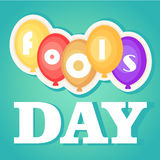 April Fool`s Day. Greeting card with balloons and font, isolated on blue gradient background. Royalty Free Stock Photography