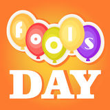 April Fool`s Day. Greeting card with balloons and font, isolated on orange gradient background. Stock Photography