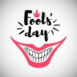 April Fool`s Day greeting card with big smile. April Fool`s Day greeting card. Typographic composition with creepy clown`s smile and bared teeth illustration Stock Photography