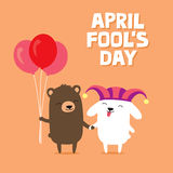 April Fool`s Day greeting card with cute bunny rabbit wearing joker hat and bear holding balloons Stock Photo