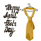April Fool s Day. Vector illustration of a smiling face. Great holiday gift card. April fool s day. Vector illustration of handwritten text. Hanger with a yellow Stock Image