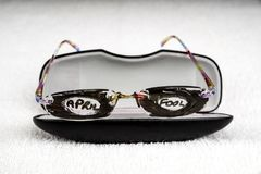 April Fool Trick Glasses. Glasses that have had the lenses covered with pen and April Fool written on stock images