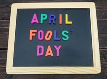 April fools day. Sign with magnetic letters on a chalkboard Royalty Free Stock Photo