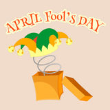 April fools day. Fool's cap with bells in a box with a spring. Vector illustration EPS10 Stock Illustration
