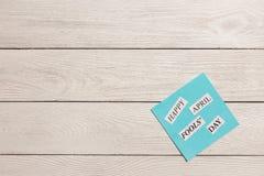 April Fools Day ha stampato la frase su fondo di legno Fotografia Stock