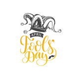 April Fools day hand lettering greeting card. Vector festive calligraphy background with jester hat illustration. Royalty Free Stock Photo