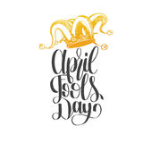April Fools day hand lettering greeting card. Vector festive calligraphy background with jester hat illustration. Stock Photos