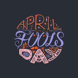 April Fools Day  Lettering. April Fools Day  Hand Drawn Lettering with smile,  jester hat and mustache for print, poster, web, greeting card, illustrations Royalty Free Stock Photo