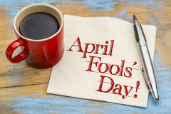 April Fools Day - napkin handwriting. April Fools` Day! Handwriting on a napkin with a cup of coffee royalty free stock photography