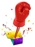 April Fools day. Red boxing glove on spring flies out of box. April Fools joke Royalty Free Stock Images