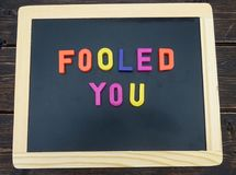 April fools day sign. On a chalkboard stock images
