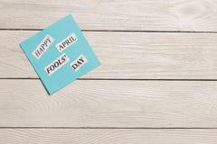 April Fools Day skrivev ut uttryck på träbakgrund Fotografering för Bildbyråer