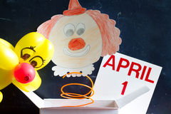 April fools day symbol concept with clown. On blackboard Royalty Free Stock Photo
