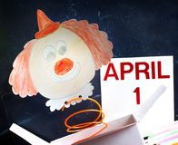 April fools day symbol concept with clown. On blackboard stock photography