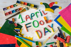 April Fools` Day text made with plasticine. On white wooden background Stock Images