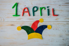 April Fools` Day text made with plasticine. On white wooden background Royalty Free Stock Image