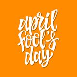April Fools Day - vector hand drawn brush pen lettering. White text on orange background. High quality calligraphy for greeting card, print, poster, banner Stock Images