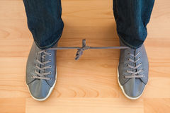 April fools with shoelaces of trainers. At home Royalty Free Stock Images