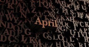 April - hölzernes 3D übertrug Buchstaben/Mitteilung Stockbilder
