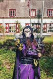 Evil man with skull mask and huge sword poses during the Elf Fan. April 19, 2014, Haarzuilens, The Netherlands: Evil man with skull mask and huge sword poses royalty free stock images