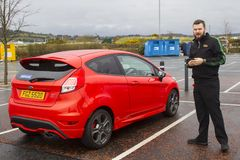10 April 2018 A happy young driver taking possession of his new Ford Fiesta 1.6 ST from a dealer in Portadown Northern Ireland stock images