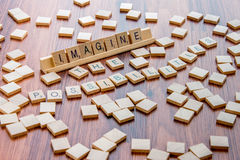 April 4, 2015: Houston, TX, USA - Scrabble tiles spelling Imagi stock photos