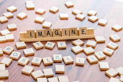 April 4, 2015: Houston, TX, USA - Scrabble tiles spelling Imagi stock image