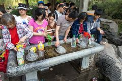 April 2015 - Jinan, China - local people taking water from the springs in the famous Baotu Quan in Jinan, China. April 2015 - Jinan, China - local people taking Stock Photography