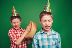 April joke. Twin boys making fun on April fool�s day Stock Photos