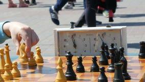 April 21, 2018 - Kamenskoye, Ukraine: Children play chess in street. Street Chess Tournament outdoor, chess clock. April 21, 2018 - Kamenskoye, Ukraine: Children stock video