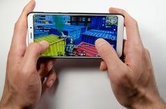 April 2019 Kramatorsk Ukraina Mobil applikationans spelar arkivbild
