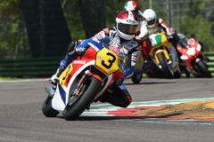 21 April 2018: Legendary driver Freddie Spencer on Honda NSR 500 during Motor Legend Festival 2018 at Imola Circuit. In Italy royalty free stock image