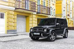 Kiev, Ukraine; April 21, 2015. Mercedes-Benz G55 AMG against the background of the yellow house royalty free stock photography