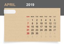 April 2019 - Monthly calendar on brown paper and wood background with area for note. Vector illustration stock illustration