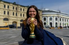 Trophy of the FIFA World Cup. April 16, 2018 Moscow. The girl is holding the Trophy of the FIFA World Cup Royalty Free Stock Images
