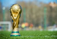 Trophy of the FIFA World Cup. April 9, 2018 Moscow, Russia Trophy of the FIFA World Cup on the green grass of the football field Stock Images