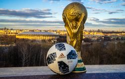 Trophy of the FIFA World Cup. April 13, 2018 Moscow, Russia Trophy of the FIFA World Cup and official ball of FIFA World Cup 2018 Adidas Telstar 18  against the Stock Photos
