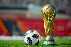Trophy of the FIFA World Cup. April 9, 2018 Moscow, Russia Trophy of the FIFA World Cup and official ball of FIFA World Cup 2018 Adidas Telstar 18 on the green Royalty Free Stock Images