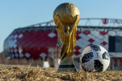 Trophy of the FIFA World Cup. April 9, 2018 Moscow, Russia Trophy of the FIFA World Cup and official ball of FIFA World Cup 2018 Adidas Telstar 18 against the Stock Images