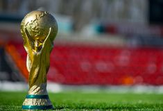 Trophy of the FIFA World Cup. April 16, 2018 Moscow. Russia Trophy of the FIFA World Cup and official ball of FIFA World Cup 2018 Adidas Telstar 18 on the Red Royalty Free Stock Image