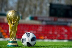 Trophy of the FIFA World Cup. April 16, 2018 Moscow. Russia Trophy of the FIFA World Cup and official ball of FIFA World Cup 2018 Adidas Telstar 18 on the Red Royalty Free Stock Photos