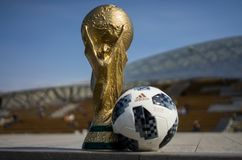 Trophy of the FIFA World Cup. April 16, 2018 Moscow. Russia Trophy of the FIFA World Cup and official ball of FIFA World Cup 2018 Adidas Telstar 18 on the Red royalty free stock photography